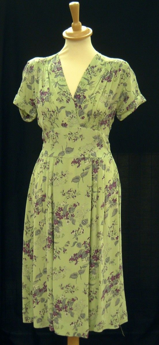 Full length picture of short sleeved green dress with blue floral pattern