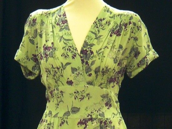 Short sleeved green dress with blue floral pattern