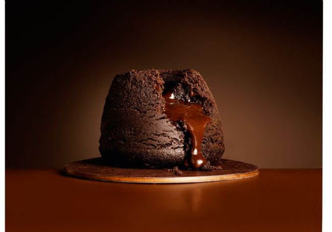 Photo of a chocolate pudding with the melting middle spilling out