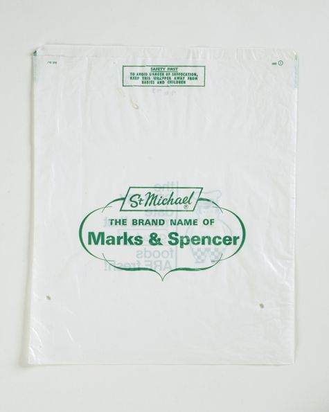 White plastic bag with green logo of the St Michael brand name