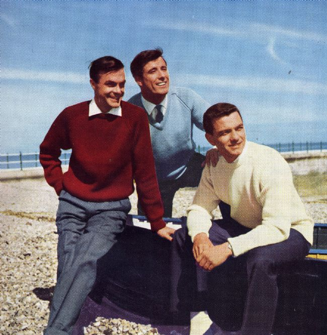 1950s Advert showing three men sitting on a beach wearing jumpers by M&S