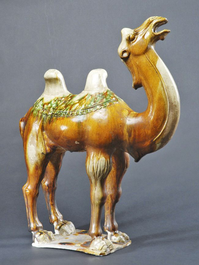 Chinese tomb figure of a camel, from the C8th Tang Dynasty
