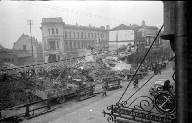 Black and White photograph of bombed building at Hull Royal Infirmary, 1941.  One building has been completely flattened.