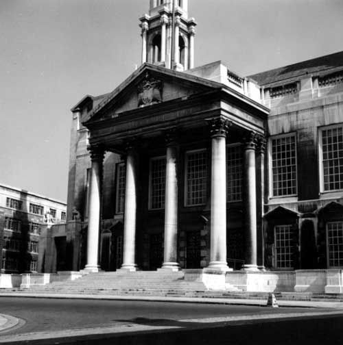 Black and white photograph of Leeds Civic Hall showing the columned entrance.