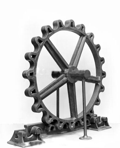 John Blenkinsop's rack and pinion, a large, cog shaped wheel, which fits neatly and securely into the piece below.