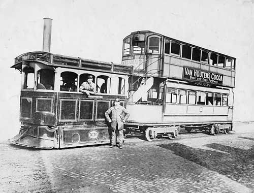 James Kitson's number 16 steam tram with a double-decker Milnes trailer.  The driver is inside the engine, with another man standing by the side.
