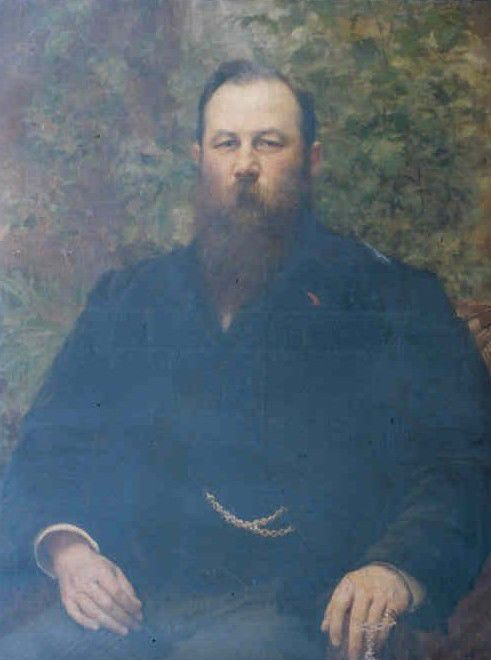 Painted portrait of Samson Fox, showing a large man with brown hair and long brown beard.  He has on a dark coat and a gold watch-chain can be seen.