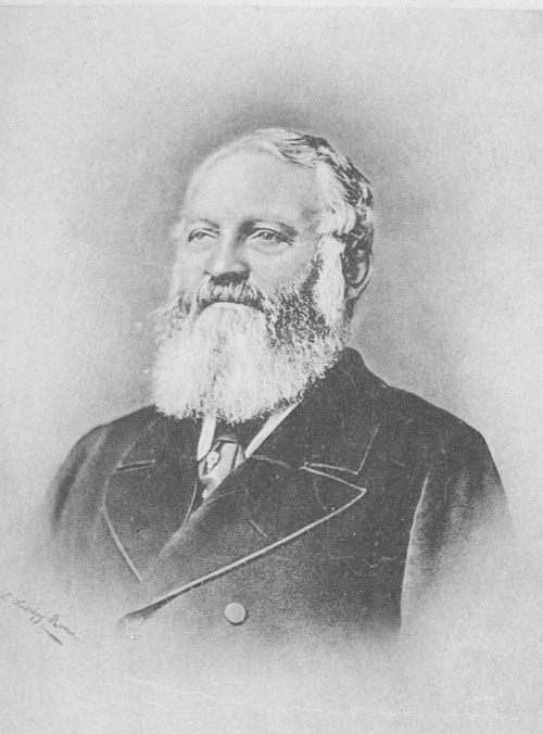 Portait of James Kitson showing a broad-shouldere dman with white hair and beard.