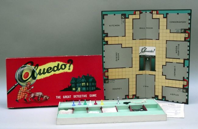 The board game Cludeo? showing the open board with all the rooms and the playing cards and pieces in the box.