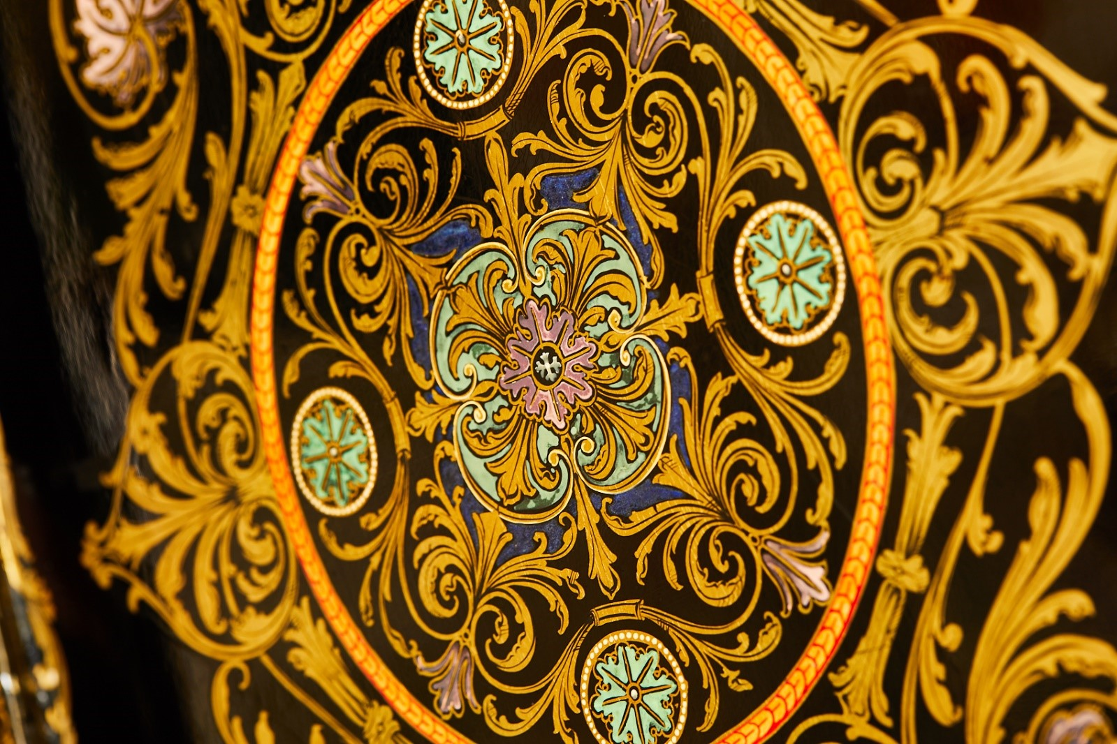 Inlaid detailed design of leaf motifs and swirls in yellow, blue and pink