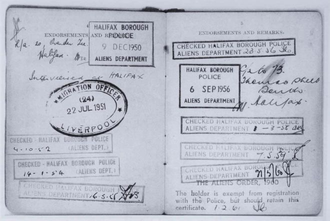 An 'alien' registration card with police stamps