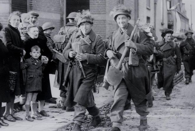 Allied troops enter Breda, Holland, during World War II