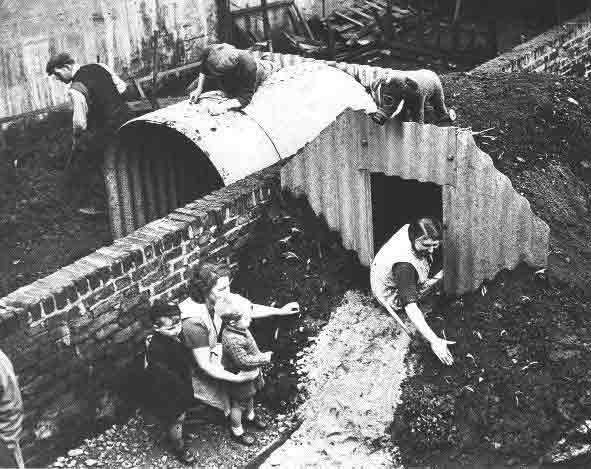 Home owners installing an Anderson Shelter in their garden