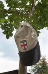 England baseball cap against background of trees