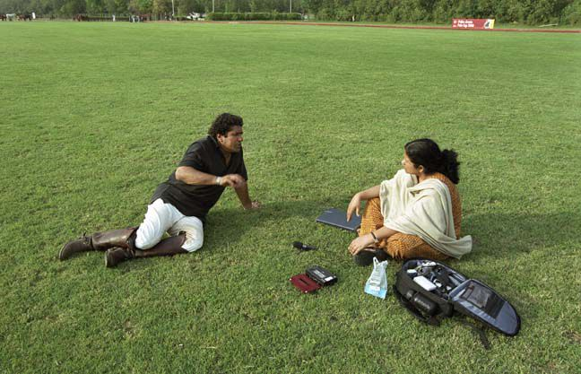 Irna Qureshi interviews polo player on field at Lahore Polo Ground