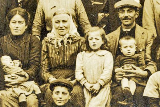 Detail of the main photo, showing a close up of some of the refugees.