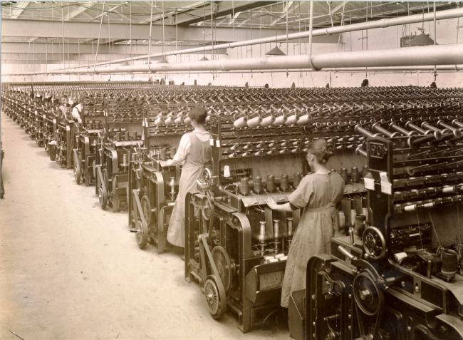 Black and white photo of Twisting Yarn at Sir Titus Salt's Mill in the early 20th Century