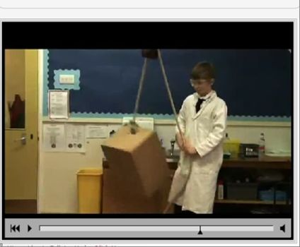 Schoolboy dressed as scientist in lab