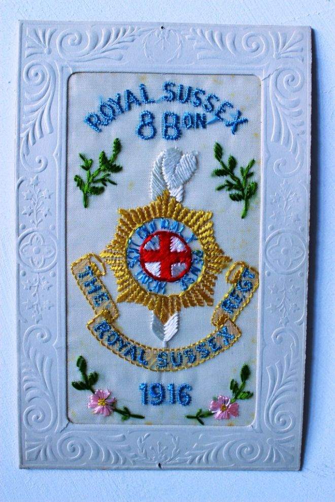 Embroidered silk WW1 postcard with regimental badge and flowers