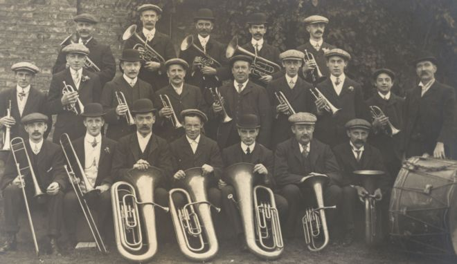 Black and white photo of male members of a Brass Band