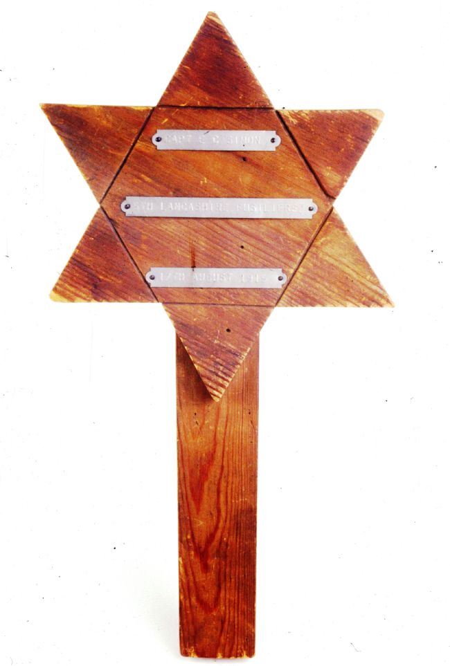 Wooden grave marker in the shape of a Star of David