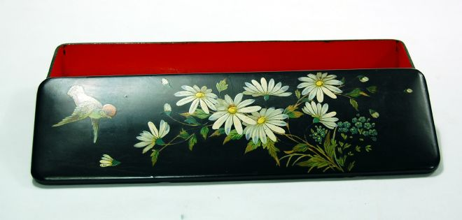 Black japanned narrow box with flowers and a bird painted on the lid.  The inside is painted a deep red.