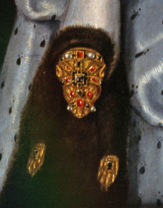 Close up of the flea fur, showind a dark brown piece of fur with bejewelled areas in teh shape of an animals head and paws.