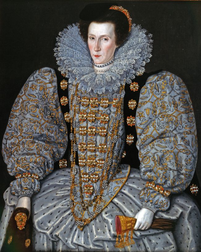 Portrait of a woman wearing a huge lace ruff and an elaborately embroidered and beaded dress.  The dress has huge sleeves.  In her had she is holding a flea fur.  Her face is very pale and her hair is drawn back from her face.