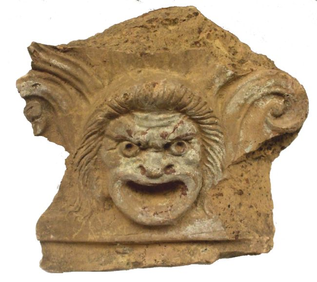 Roman Antefix - slab of stone from a wall depicting a person's face with a menacing grin