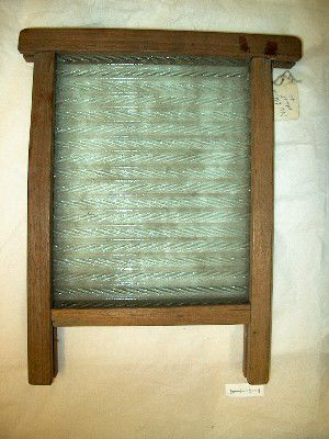 Wooden frame with a ridged glass panel in the middle