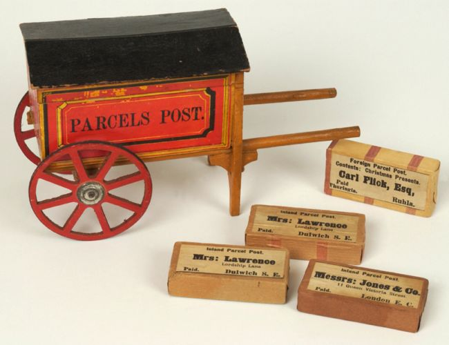 Wooden model horse drawn post van with four small wooden parcels