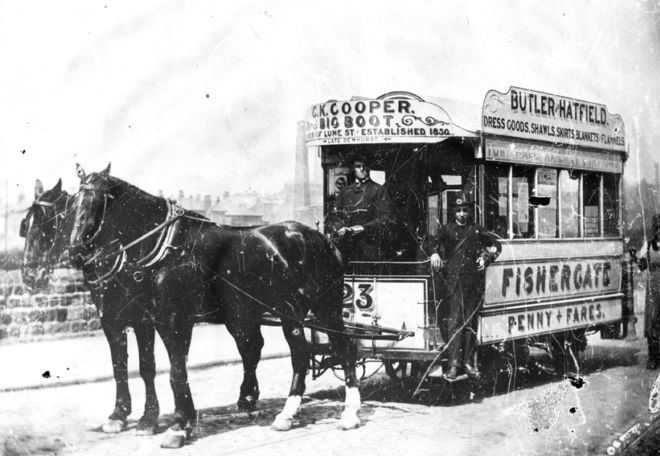Horse drawn tram in Preston with two horses pulling it.