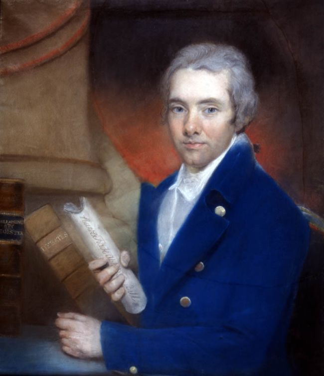 A youngish William Wilberforce is wearing a bright blue coat and holding a folded paper.
