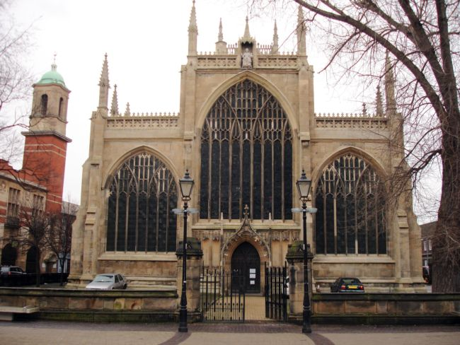 Holy Trinity Church, Hull - .  It has three large, arch shaped stained glass windows at the front with many small turrets.