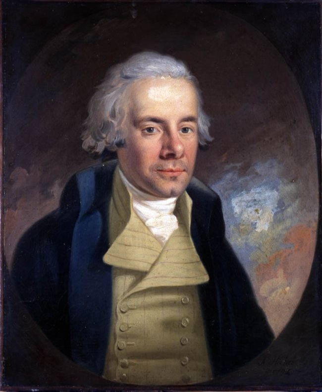 William Wilberforce, oil painting by Karl Anton Hickel, 1794. William is shown with light grey hair and a blue jacket with a stand-up collar.
