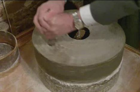 Turning a hand quern