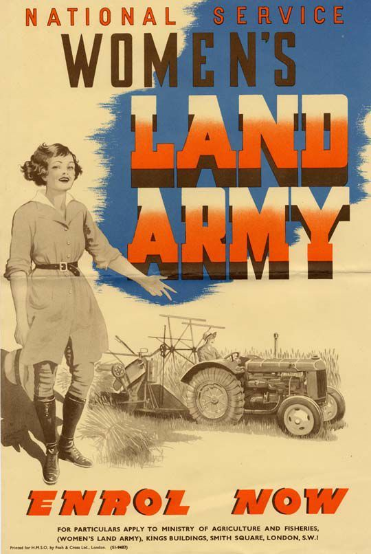 Poster shows a woman standing in uniform with a tractor in the background and has the words 'Women's Land Army Enrol Now' in capital letters.