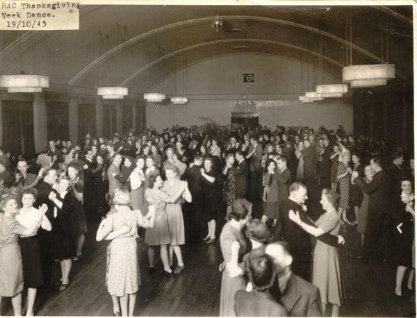Black and white photograph showing couples dancing in a big hall.  There are a few men, but mostly women.
