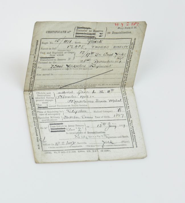 Photograph of certificate with typed and hand-written text