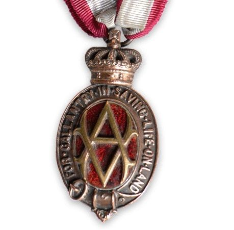 Gold WW1 Albert Medal, with letter 'A' in the centre, hanging from red and white ribbon