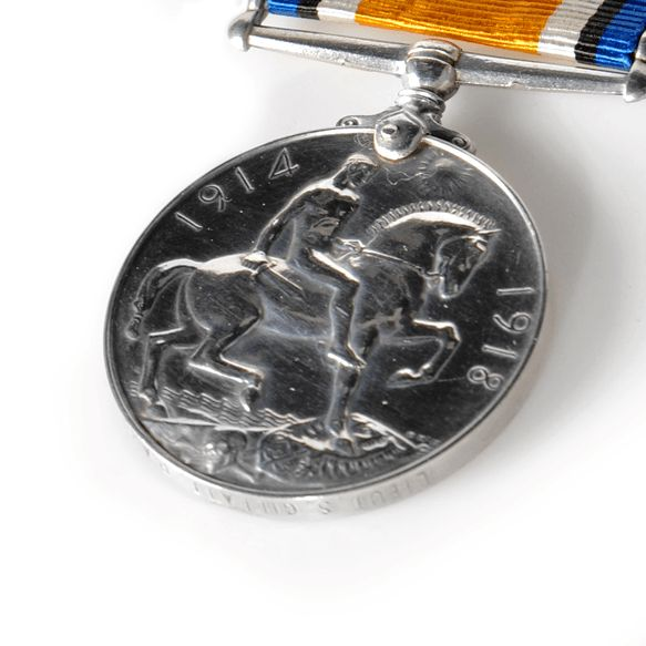 Reverse of British War Medal showing a figure on a horse with the dates 1914  and 1918 around the edge.