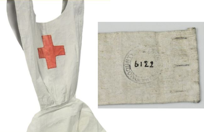 White apron with red cross on the front