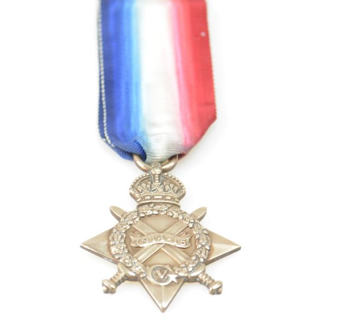 The 1914-15 Star medal, made of bronze with a red, white and blue ribbon.  The medal has three points and crossed swords.