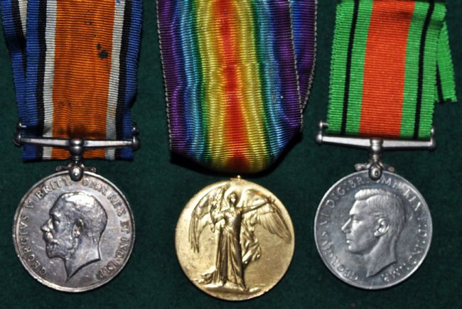 Three medals, two silver coloured, one gold coloured.