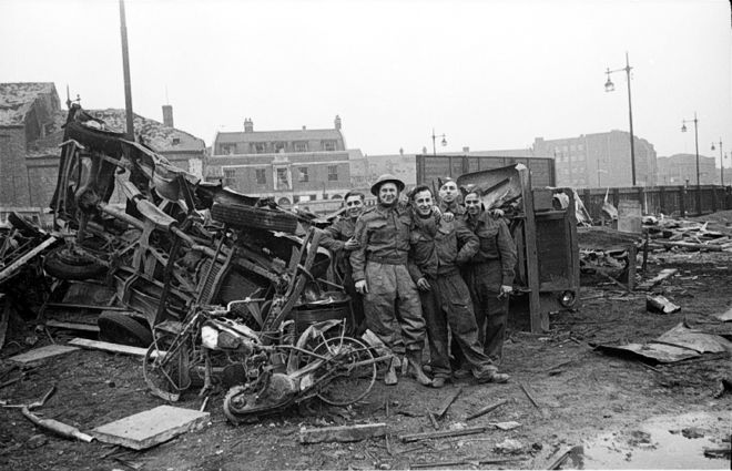 Photo of men standing next to rubble on Ferensway, Hull