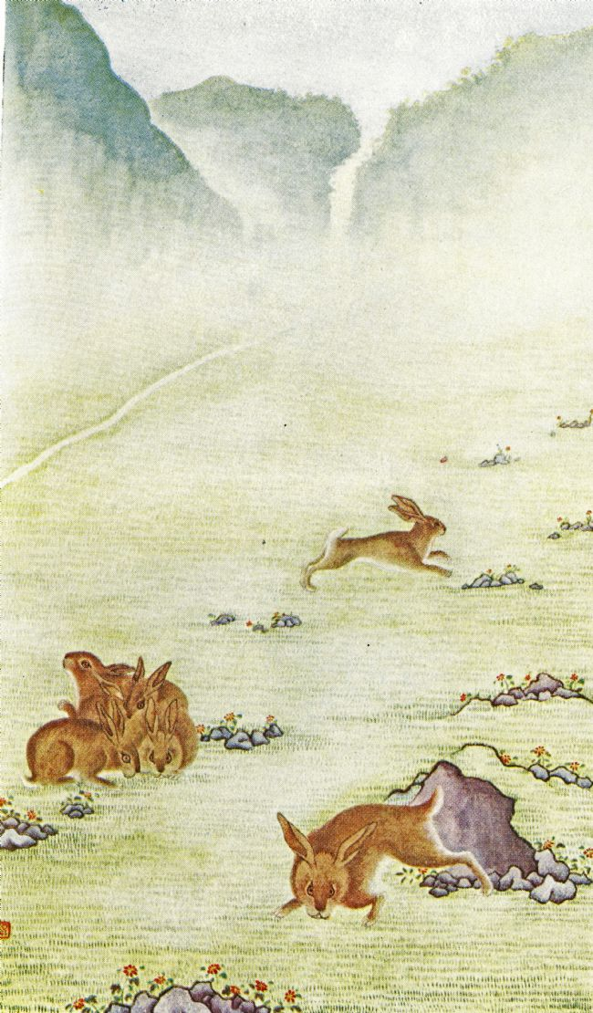 Colour illustration showing tall cliffs in the background, with short grass, rocks and boulders and several rabbits  in the foreground.