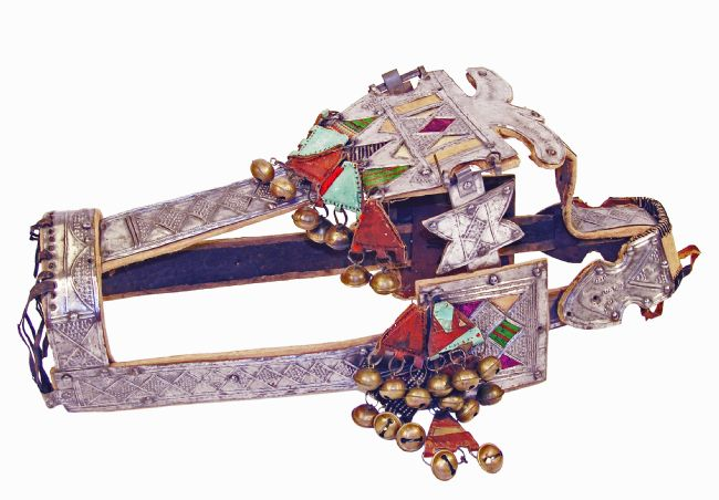 Horse headdress made from engraved silver metal, with fabric triangles and bells.