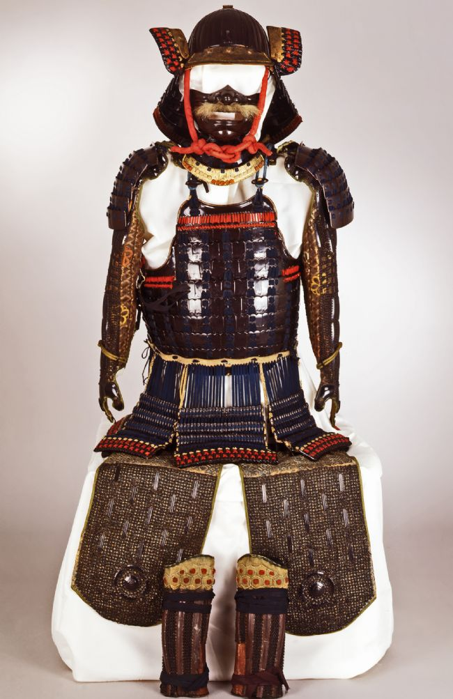 Full armour, with helmet, arm guards, body protection, thigh protection and shin guards.