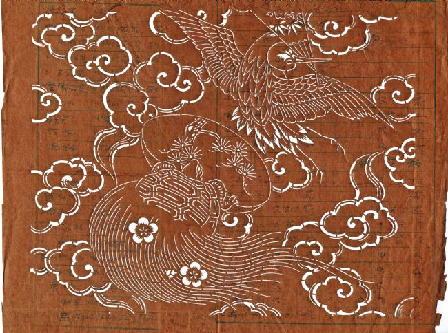 Japanese katagami stencil design telling story of Urashima Taro.  It shows a bird flying among clouds and a styalized turtle