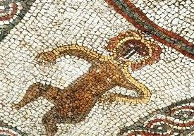 Colour photograph of a close up of part of the mosaic showing a figure.